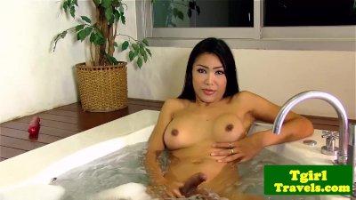 Busty ladyboy jerking cock in bathtub