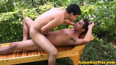 Twinks pissing outdoors before sucking dick