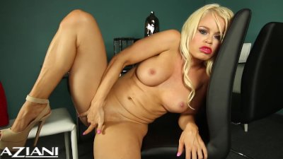 Hot blonde Nikki strips off her dress and fingers her pretty pussy.